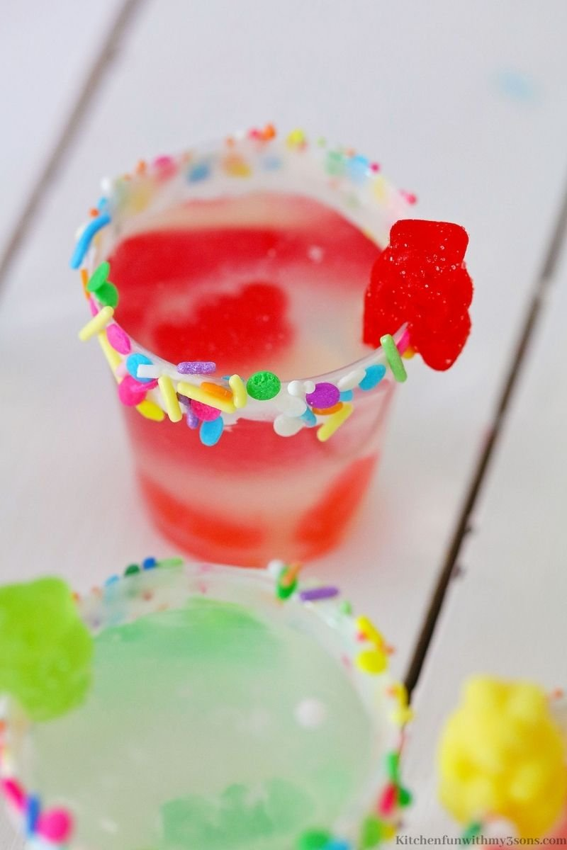 The shot glass with a gummy bear on the rim.