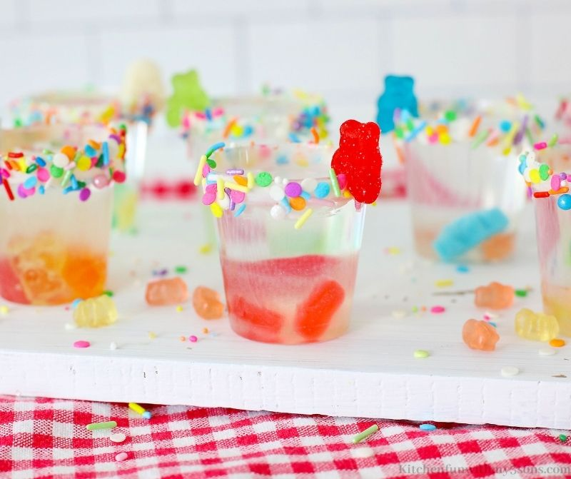 The shot glasses with extra gummy bears around.