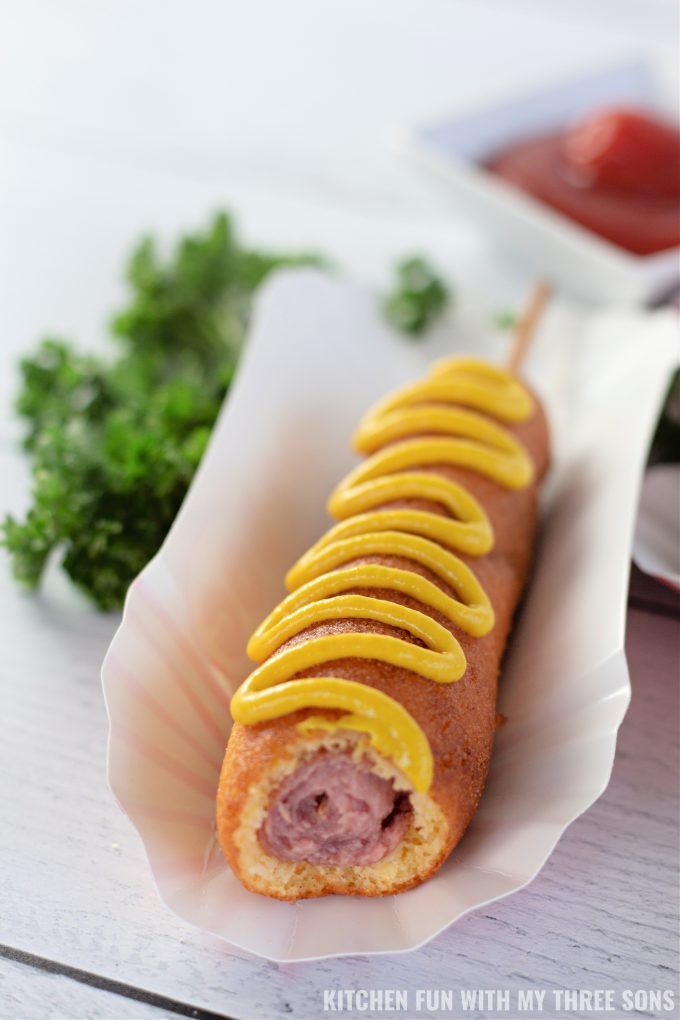 Homemade Corn Dogs with a bite taken out.