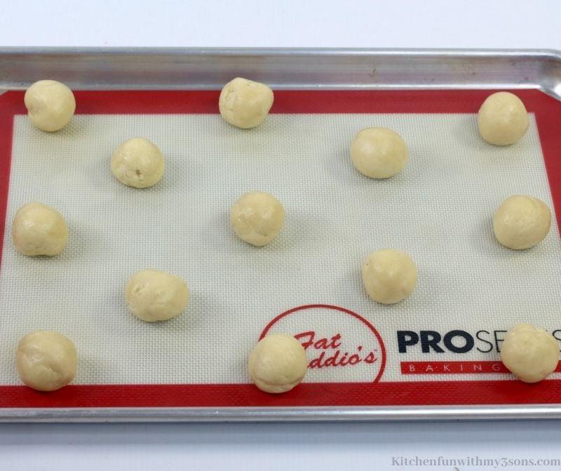 The dough balls on the pan.