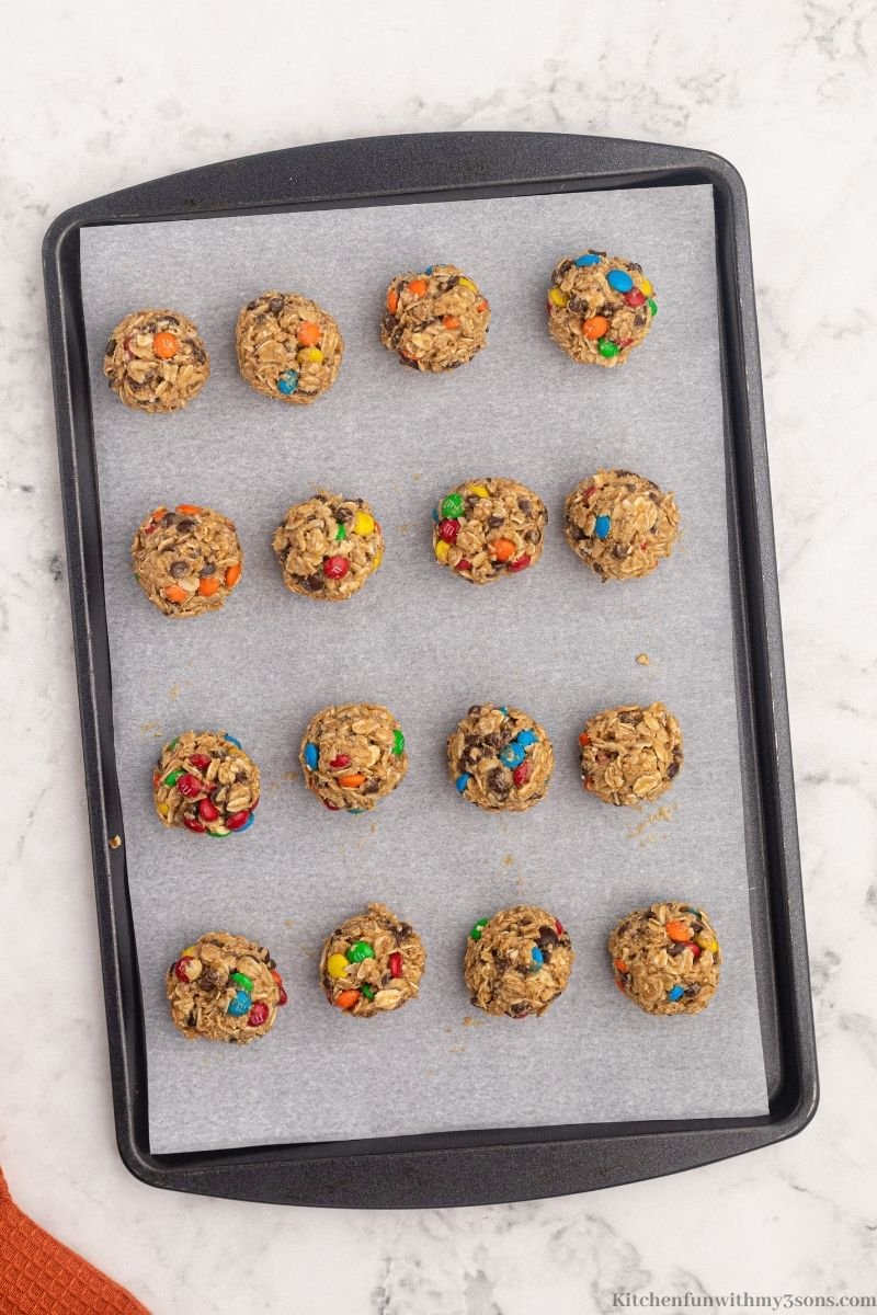 The balls of dough arranged on a cookie sheet.