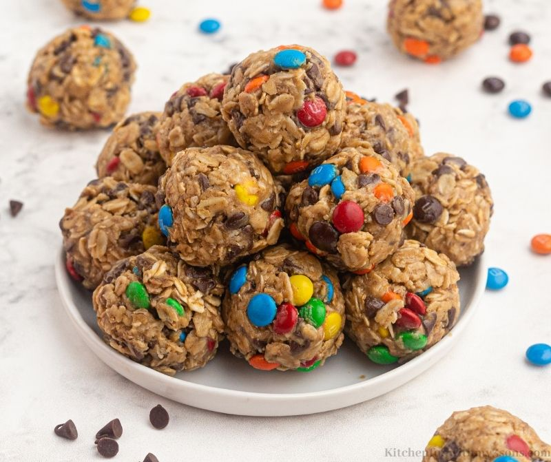 Some of the bites on a serving plate with extra chocolate chips and M&M's.