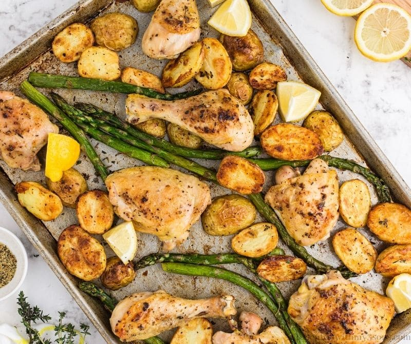 All of the cooked chicken and veggies on the sheet pan.