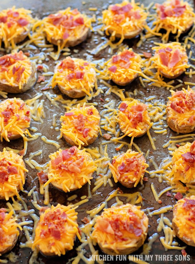 potato slices topped with cheese and bacon.