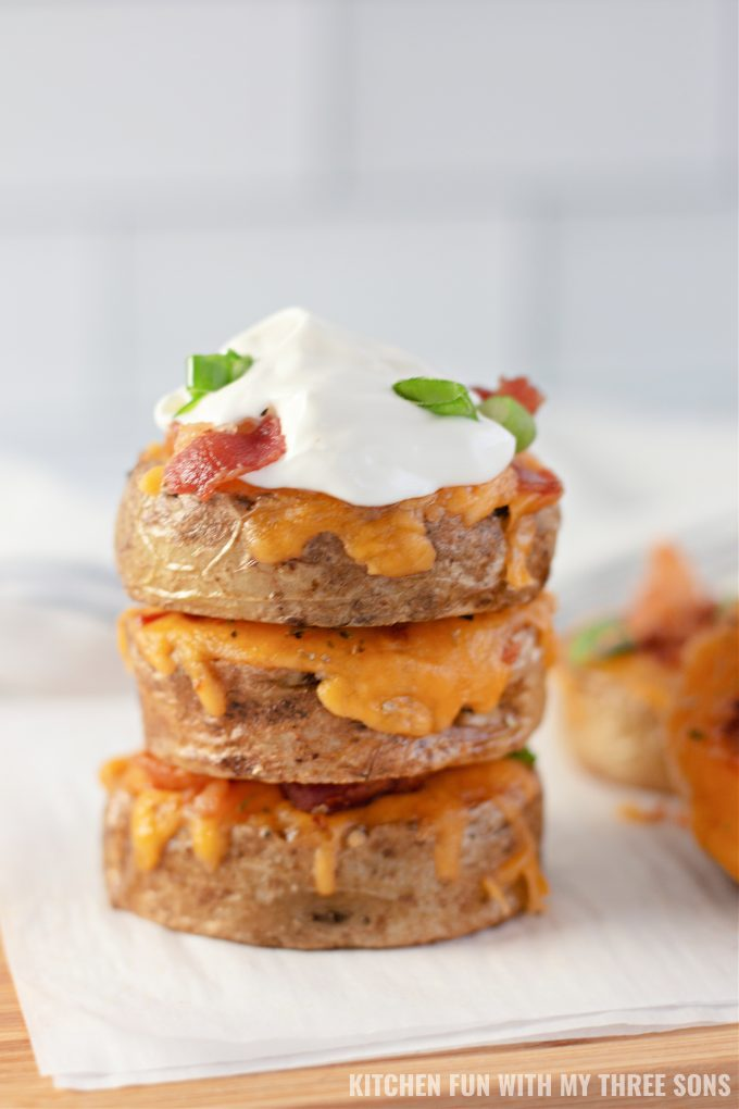 stacked Loaded Sliced Baked Potatoes with sour cream.