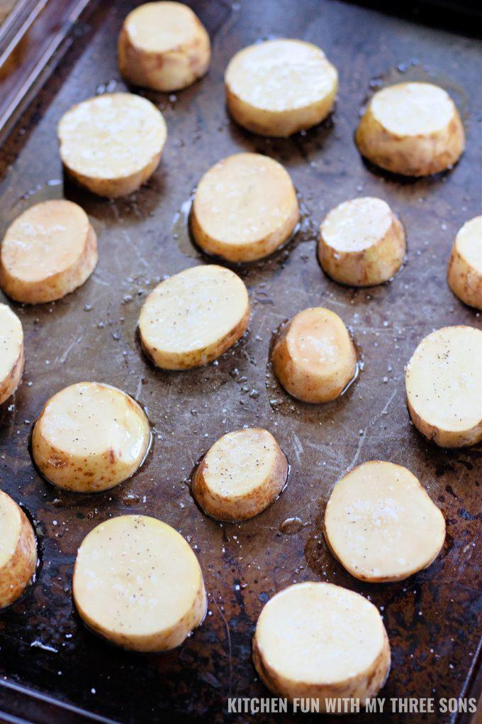 baking potato slices on a cookie sheet.
