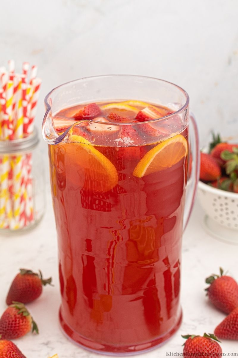 The pitcher with the strawberry tea in it.