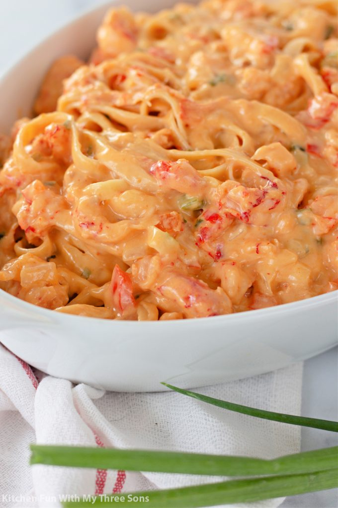 white casserole dish filled with Crawfish Fettuccini.