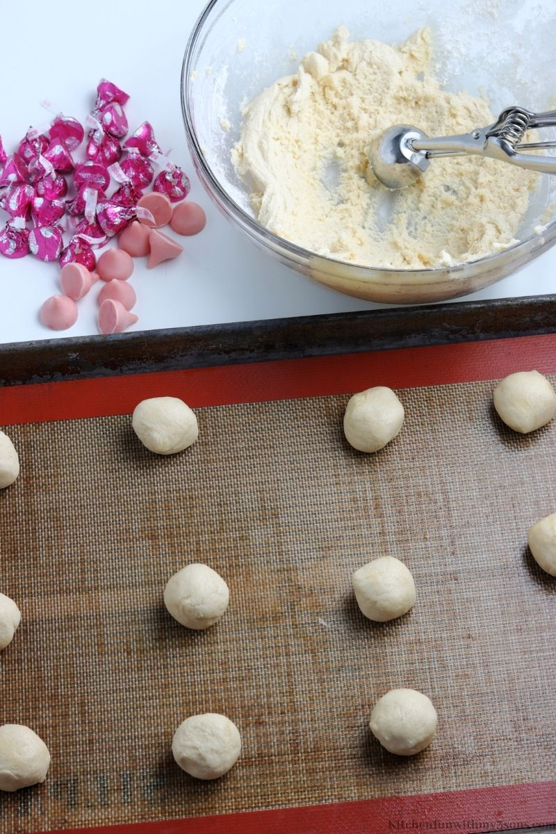 the dough rolled into balls and on a sheet pan.