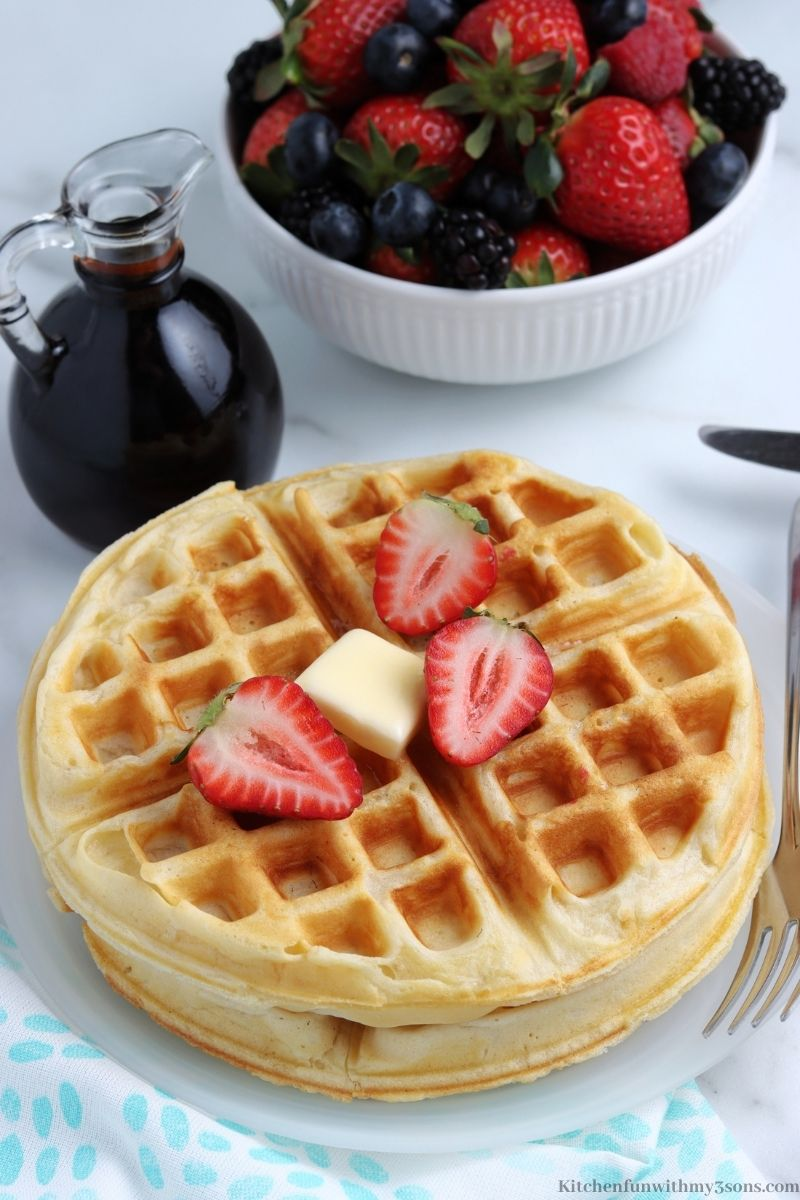 The finished waffles topped with cut strawberries.