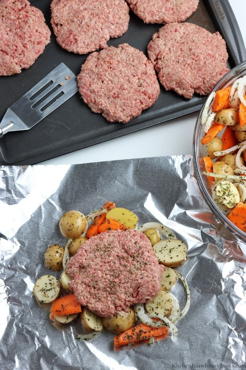 Placing a patty on top of the veggies.