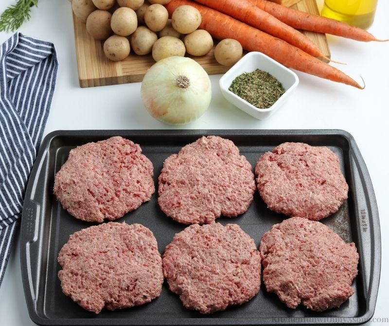 The meat formed into patties.