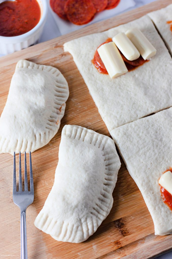 forming the pizza pockets and using a fork to crimp the edges.
