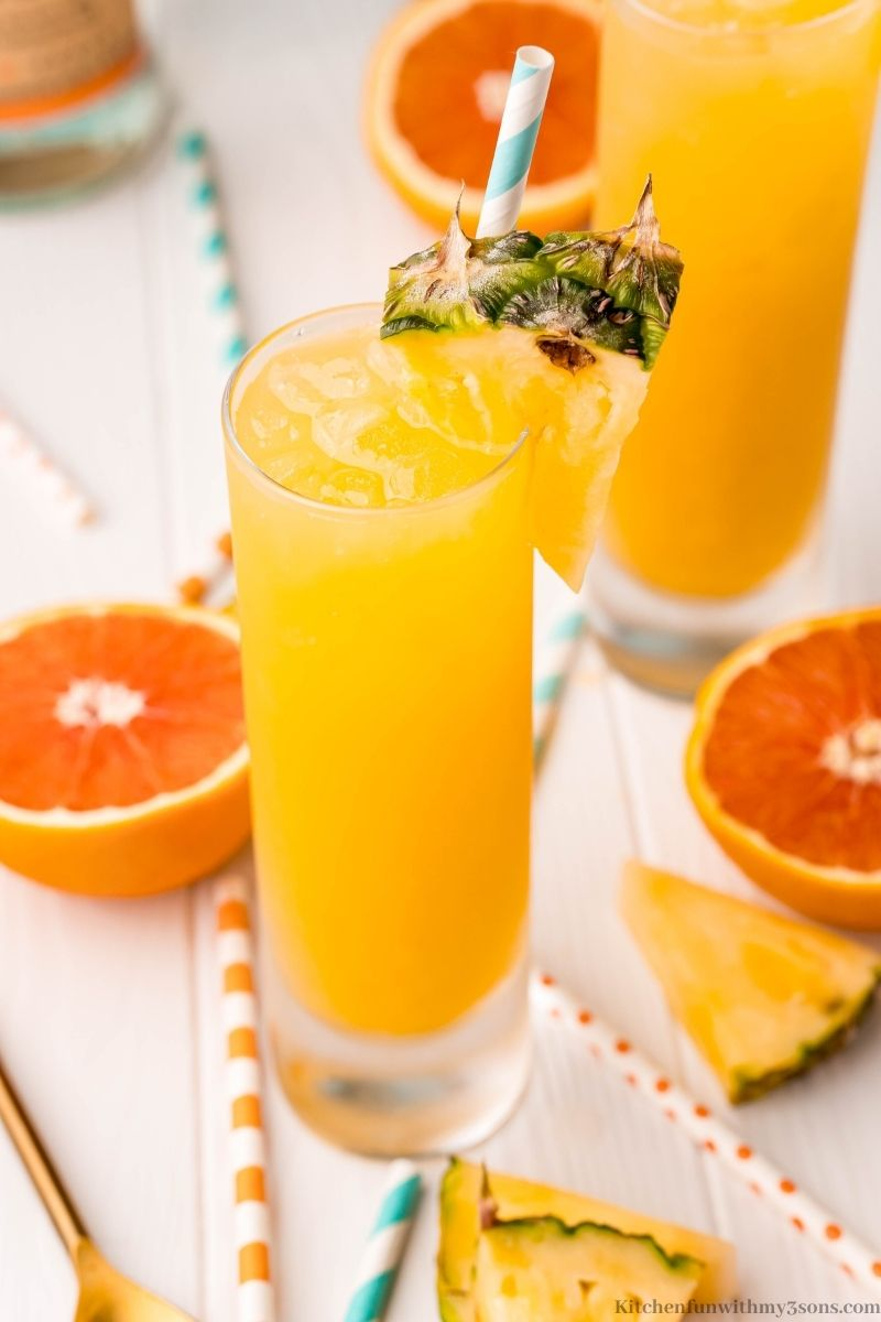 The cocktail with half oranges.