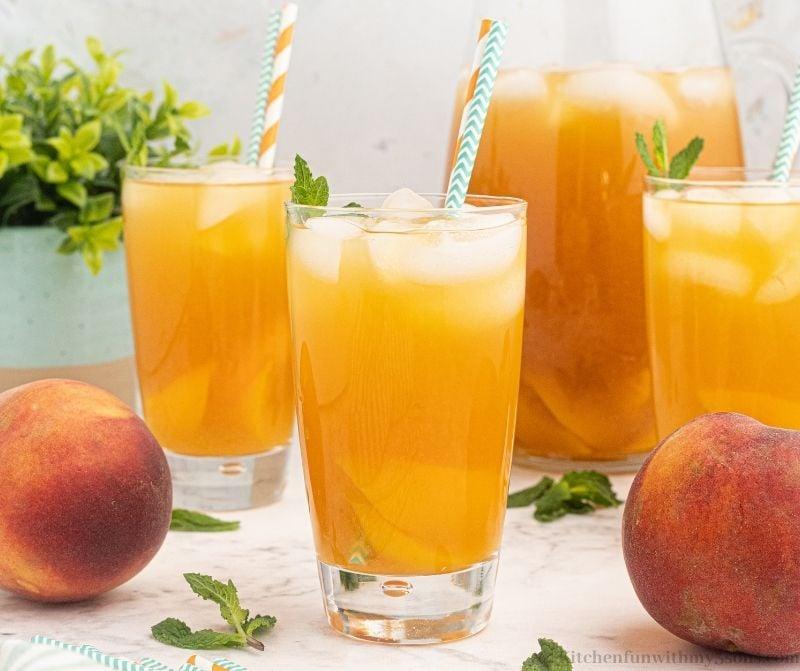 The peach tea with straws.