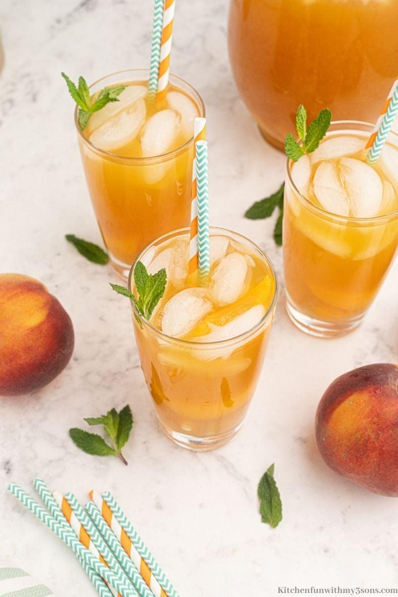 The peach tea with ice inside.