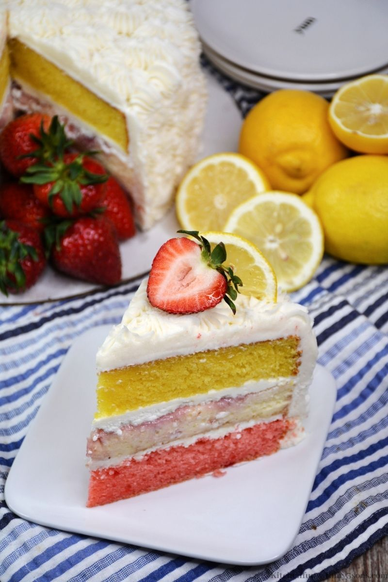 The cake topped with lemon slice and strawberry.