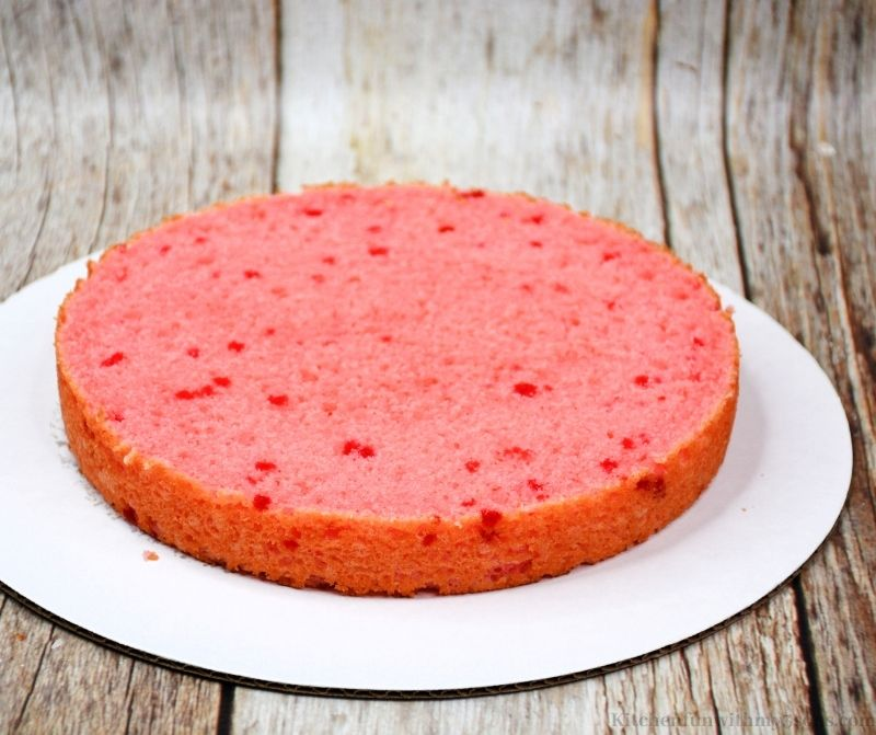 The strawberry layer on a cake board.