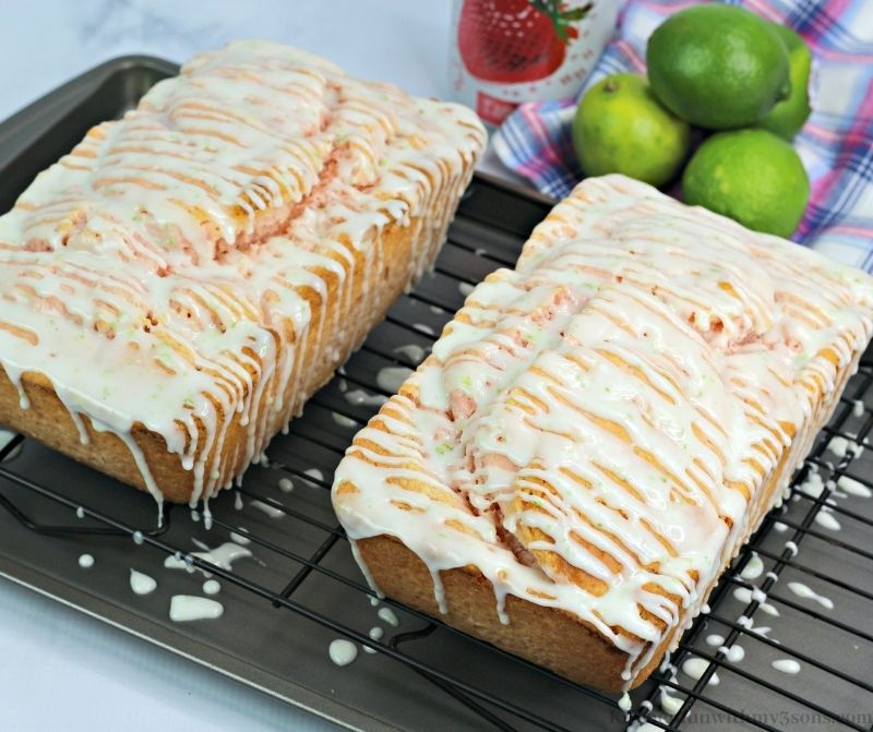 Drizzled glaze on top of the two Margarita Strawberry Bread loaves.