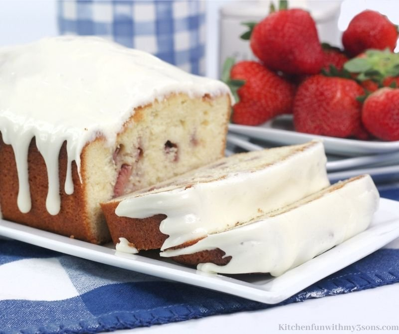 Strawberry Pound Cake with strawberries behind it.