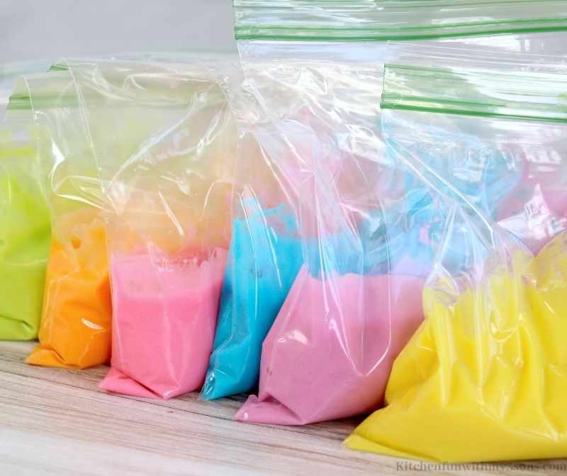 Adding the colored batter into the bags.