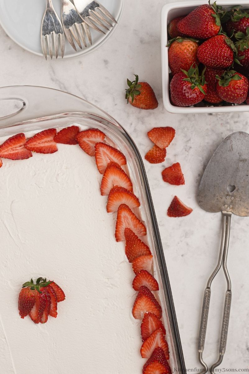 Tres Leches Cake with strawberries wrapped around the boarder.