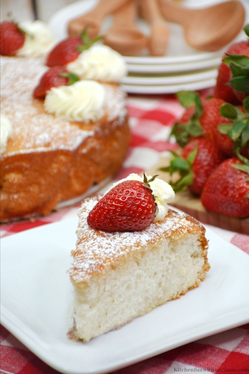 The cake with a strawberry on top.