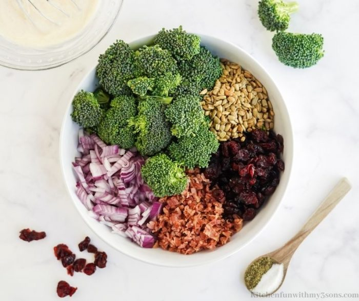 All of the salad ingredients in a bowl.