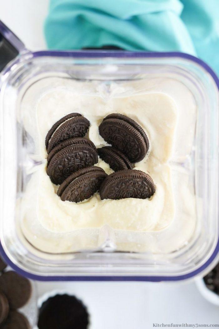 Adding the Oreos into the ice cream.