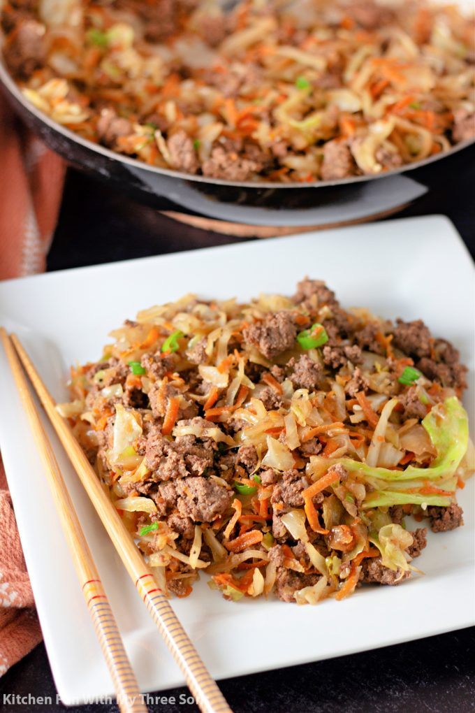 Egg Roll in a Bowl on a plate with chopsticks.