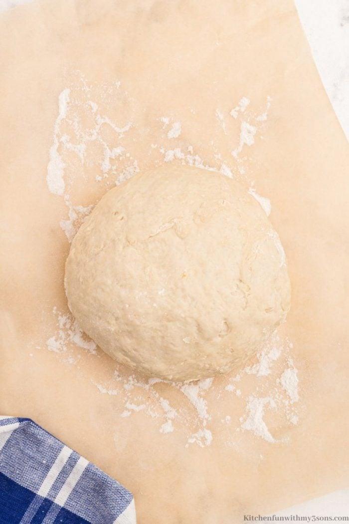 the dough ball on a lightly floured surface.