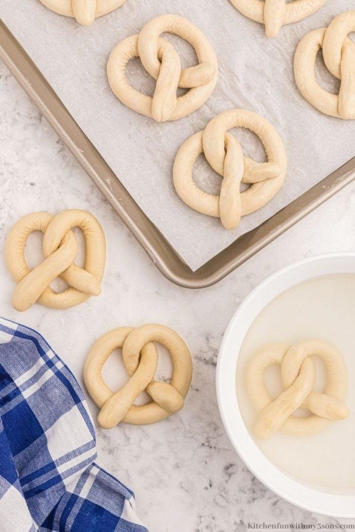 Soaking the pretzel dough.
