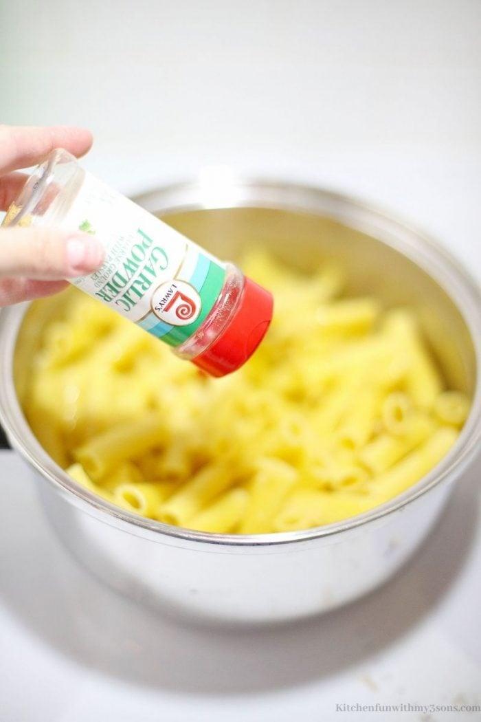 adding seasoning to a bowl