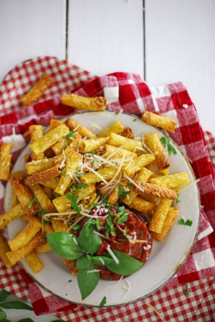 air fryer pasta chips with a red and white checkered naplin