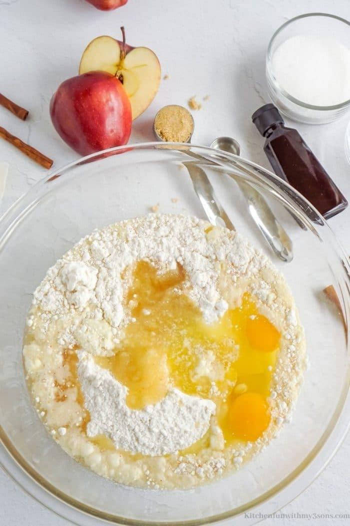 Adding the eggs into the flour.