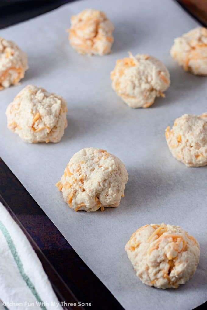 biscuit dough on a baking sheet lined with parchment paper.