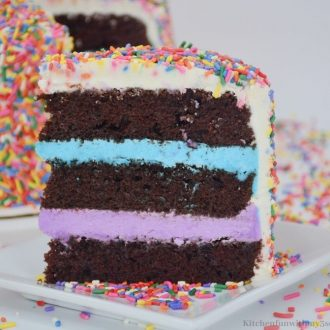 A piece of the cake showing off the blue and purple frosting inside.