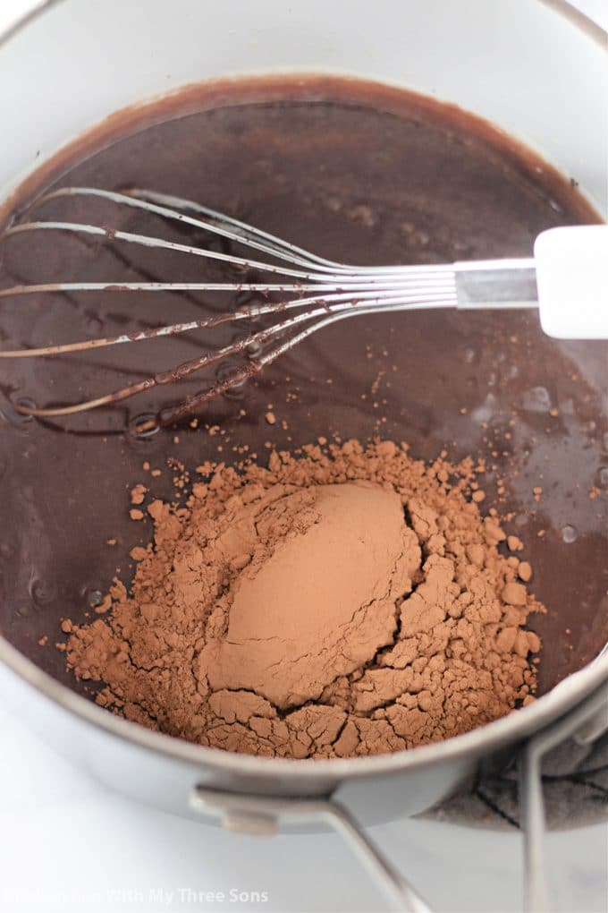 whisking cocoa powder into the sauce.