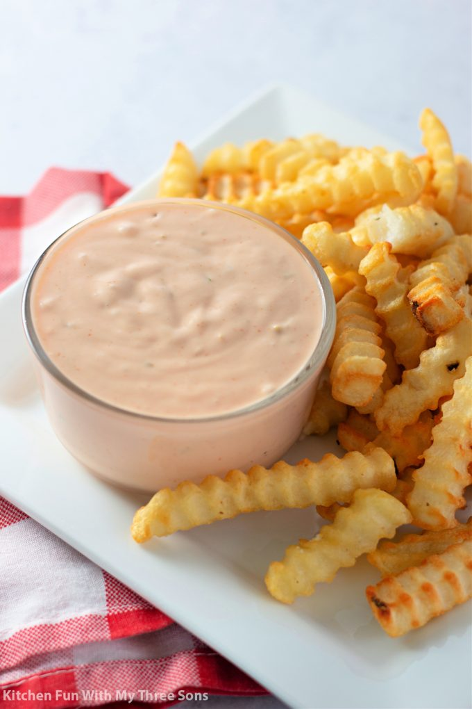 Dipping fries in Burger Sauce.