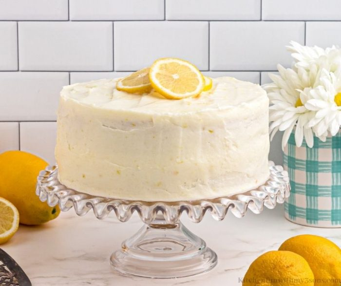 the whole lemon cake with lemon slices on top.