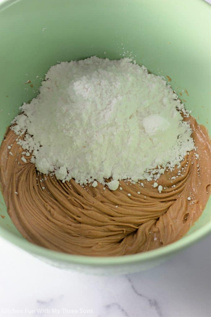adding powdered sugar to the whipped peanut butter.