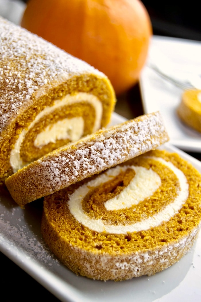 Pumpkin Cake Roll is everyones favorite fall dessert. This moist pumpkin cake is filled with a cream cheese filing and delicious pumpkin spices.