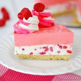 A slice of cheesecake on a serving plate.
