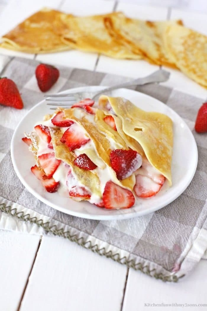 The crepes on a checkered grey and white cloth.