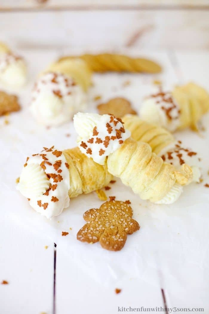The cream horns with a gingerbread cookie.