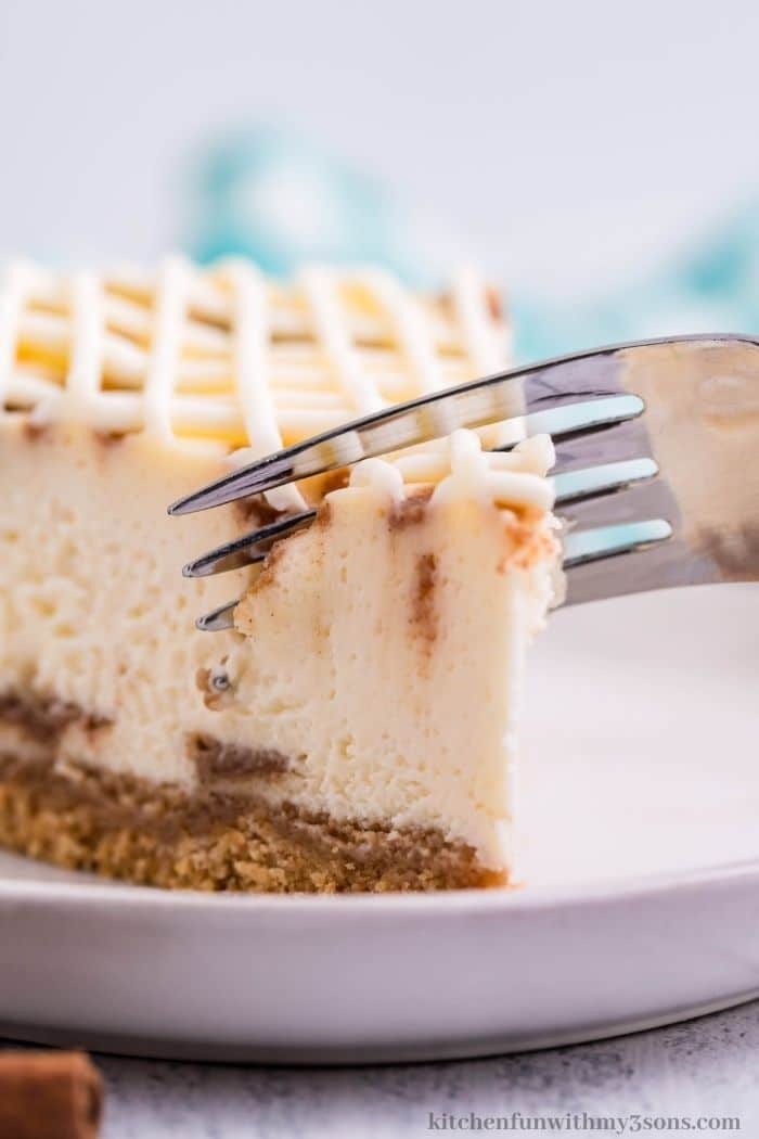 Taking a bite out of the cheesecake slice.