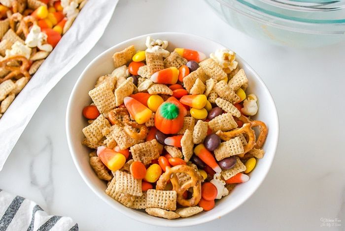 This Halloween Snack Mix is the perfect treat to make for a classroom, a pumpkin carving party or movie night. It's full of cinnamon butter coated pretzels, Kettle corn and lots of festive candy.