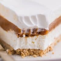 An up close shot of a pie with a bite taken out of it.