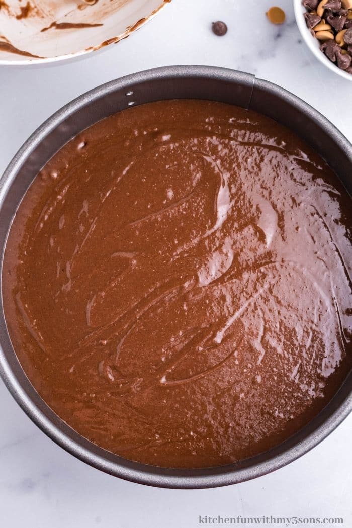 The brownie layer in the pan.