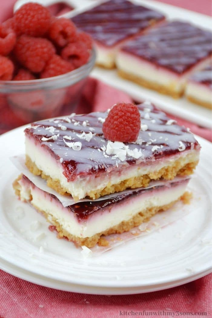 The bars topped with a fresh raspberry.